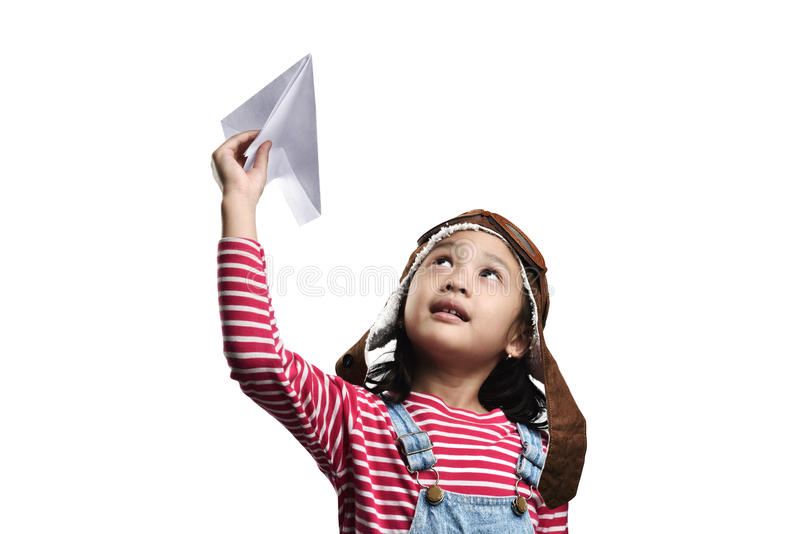 Happy asian little girl playing with toy paper airplane. Isolated over white background royalty free stock images