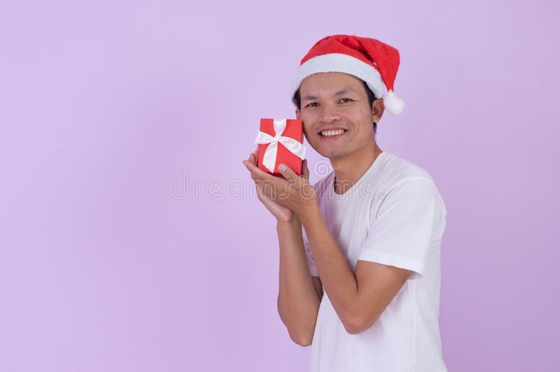 Happy Asian man is a shopping in Christmas day royalty free stock images