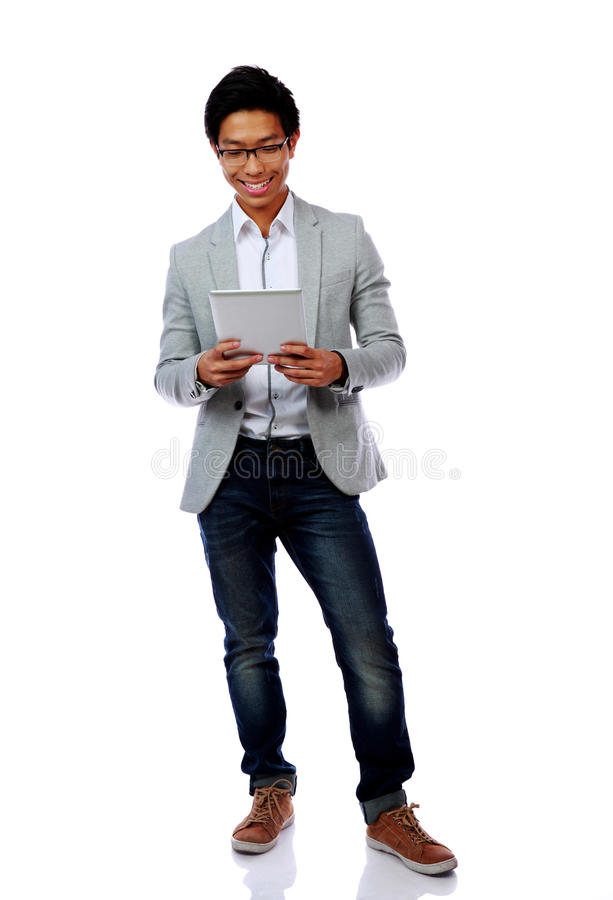 Happy asian man using tablet computer stock images