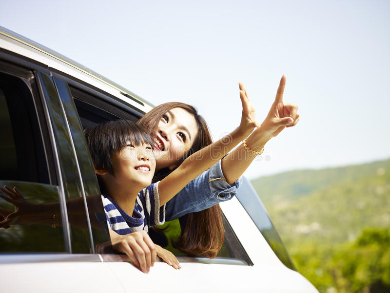 Happy asian mother and daughter on a sightseeing trip stock image