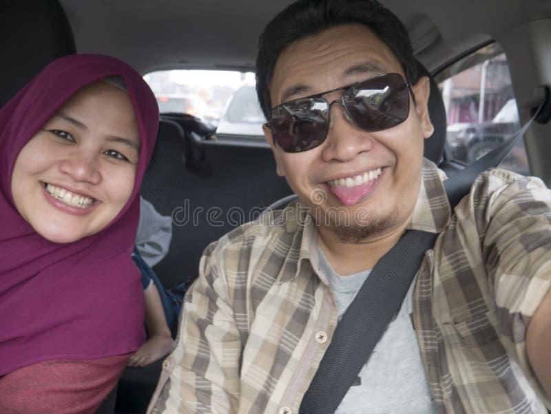Happy Asian Muslim Family in Mudik Trip stock photo