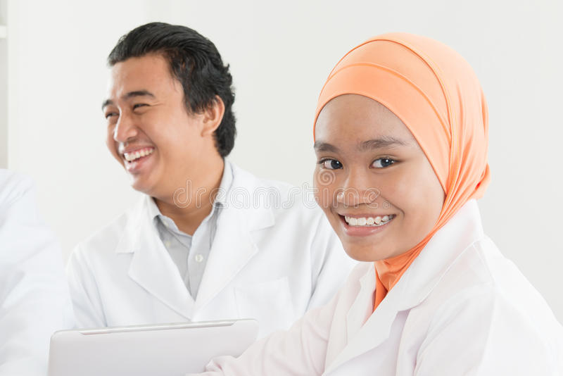 Happy Asian muslim nurse stock photo
