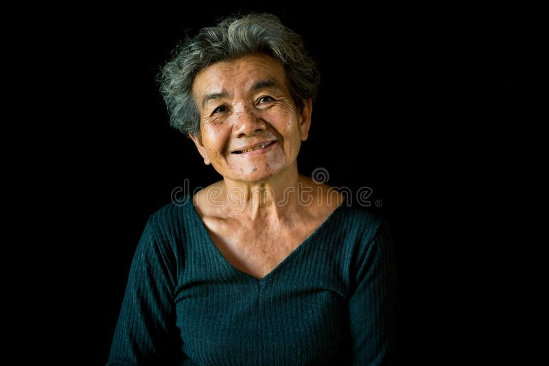 Happy Asian old woman smiling and joyful stock photography