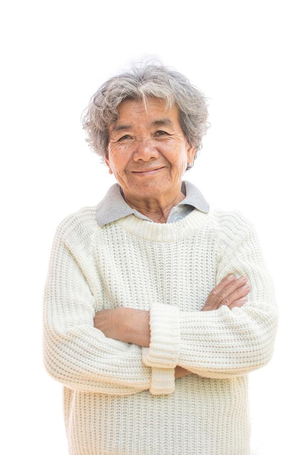 Happy Asian old woman smiling and joyful on white royalty free stock image