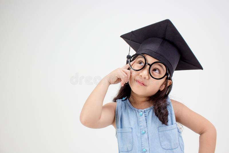 Happy Asian school kid graduate thinking royalty free stock images