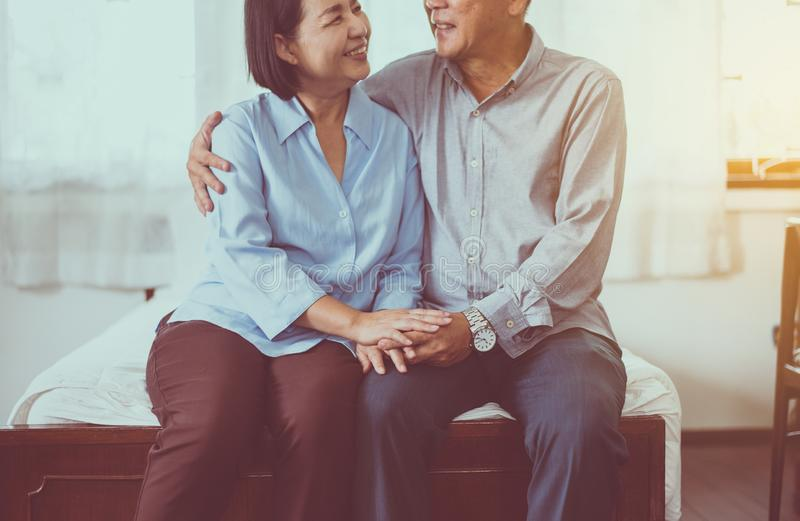 Happy asian senior couple encourage and hugging on bed together,Happy and smiling,Positive thinking royalty free stock images