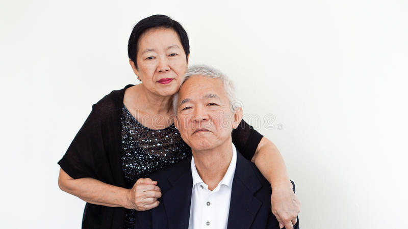 Happy Asian senior couple, family business partner portrait together stock photo