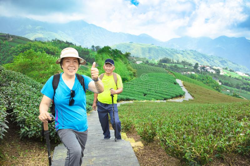 asian senior couple hiking in the nature stock photography