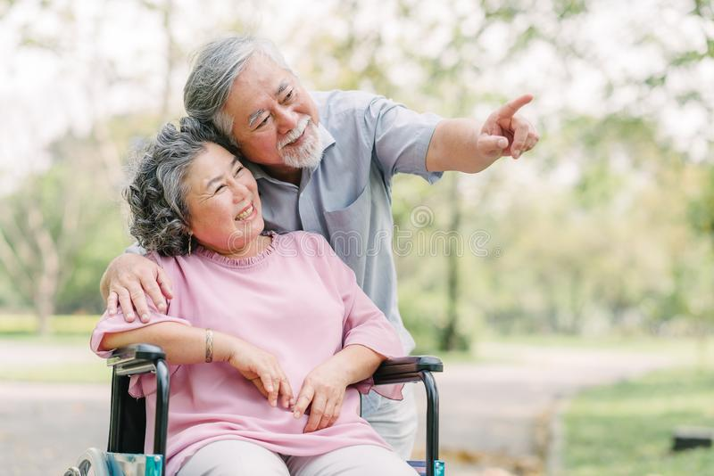 Happy Asian senior couple smiling outside stock images