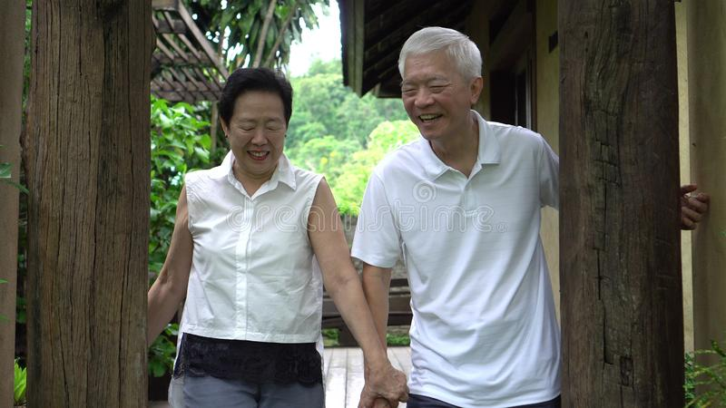 Happy Asian senior elder hide and seek playful stock photography