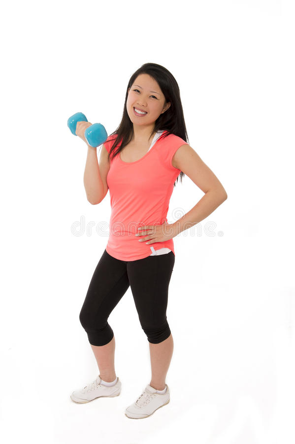 Happy asian sport woman holding lifting dumbbell stock photography