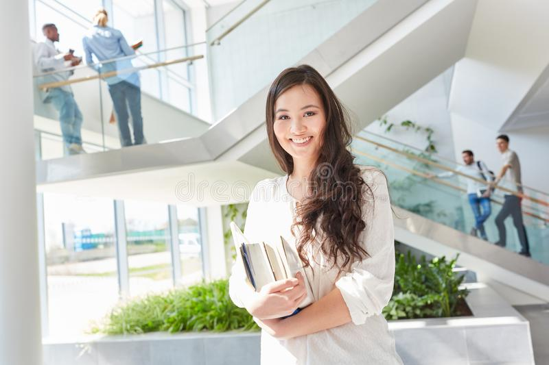 Happy asian student with books royalty free stock photography