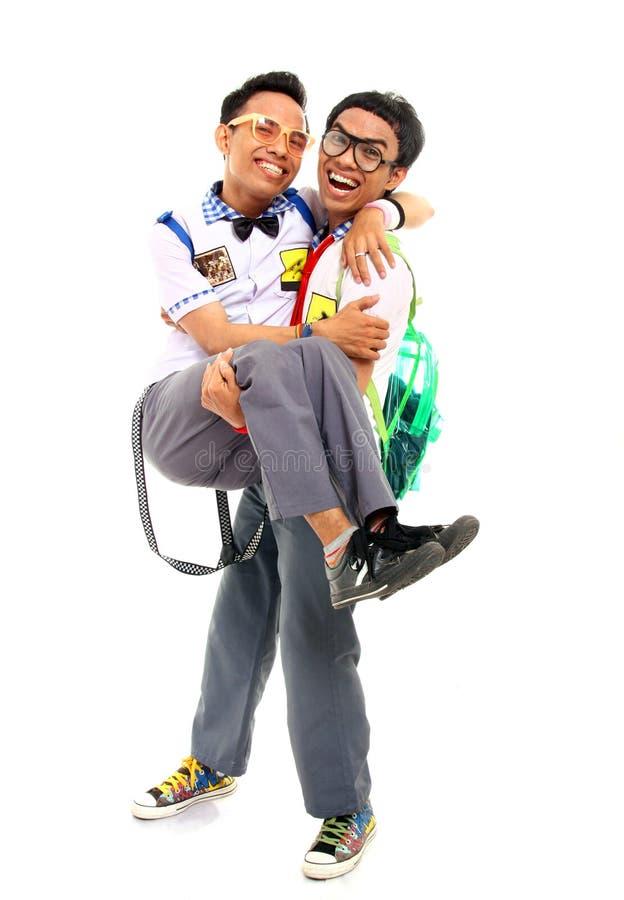 Happy asian student in uniform stock photo