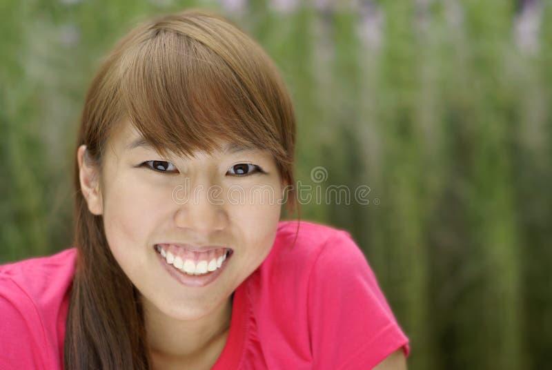 Happy asian teen girl smile royalty free stock photo