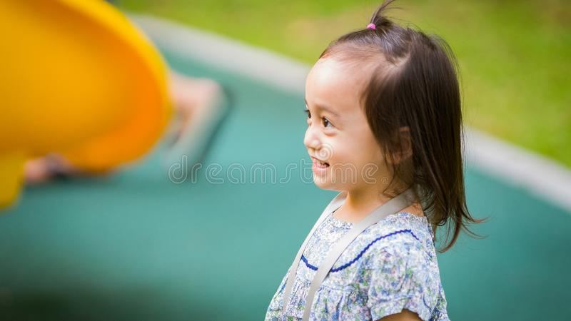Happy Asian toddler kid is smiling. Happy Asian toddler kid is playing in the outdoors at the park royalty free stock image