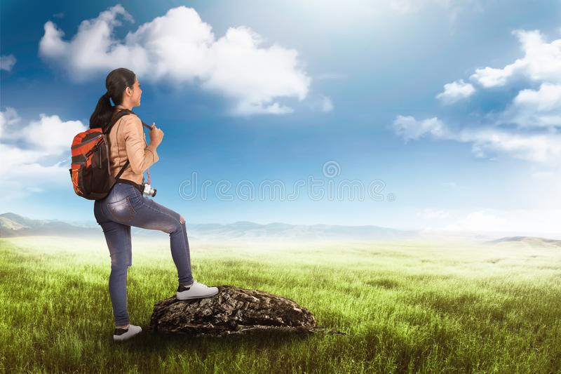 Happy asian tourist woman with bag on her back enjoy the view royalty free stock photos