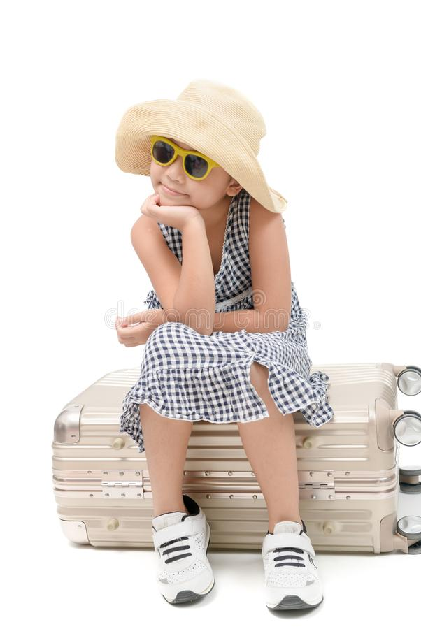 Happy asian traveler sit on baggage isolated stock photos