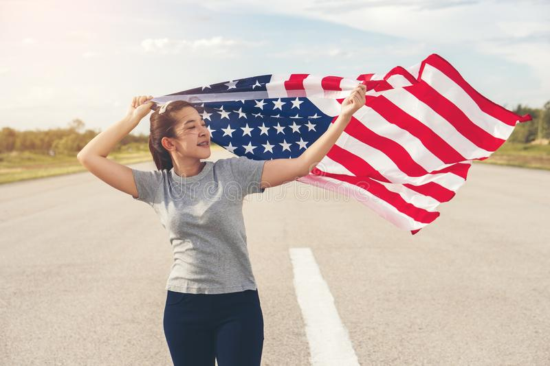 Happy asian woman with American flag USA celebrate 4th of July.  royalty free stock photos