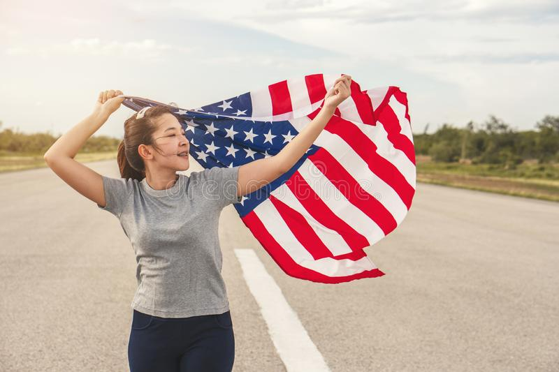 Happy asian woman with American flag USA celebrate 4th of July.  royalty free stock photography
