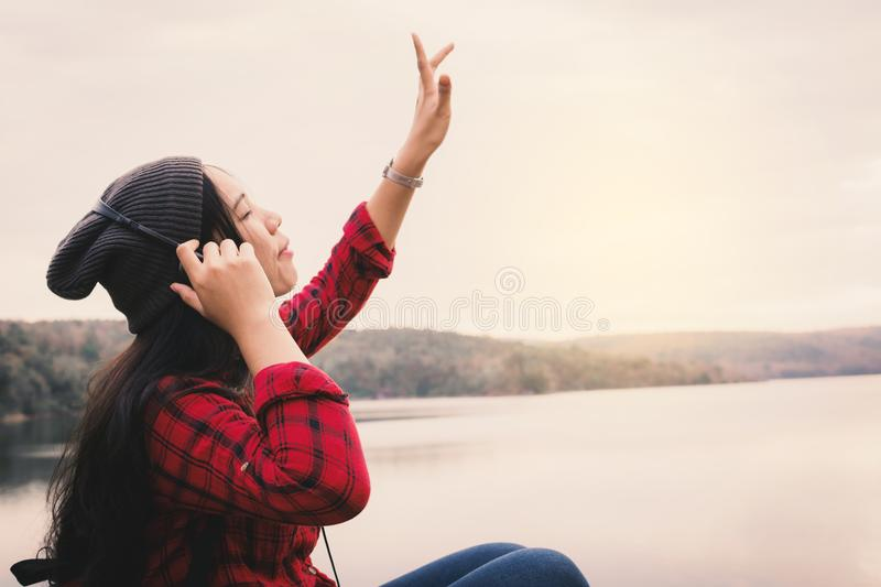 Happy Asian woman backpacker relaxing on holiday travel concept royalty free stock images