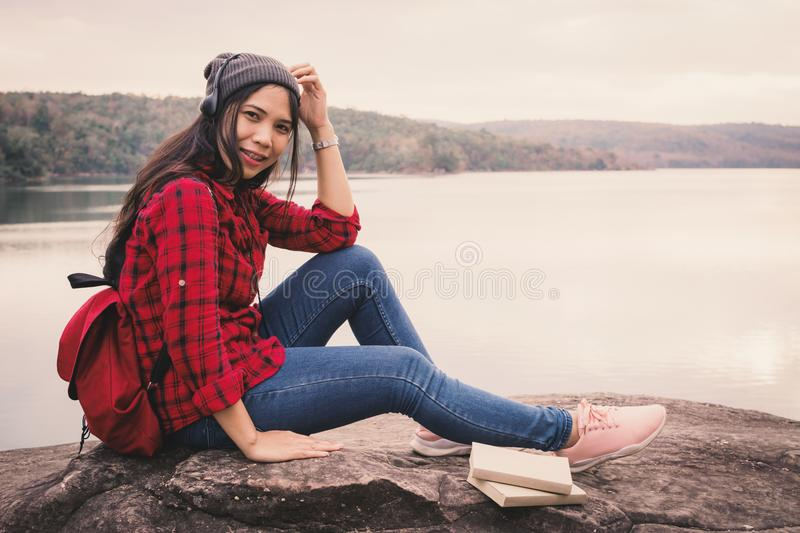 Happy Asian woman backpacker relaxing on holiday travel concept royalty free stock image