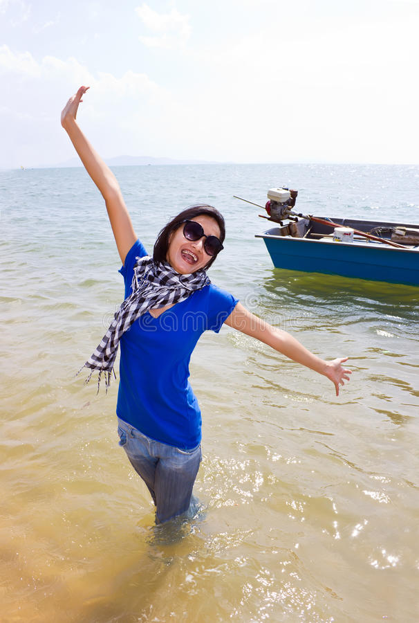 Happy Asian woman on the beach stock photography