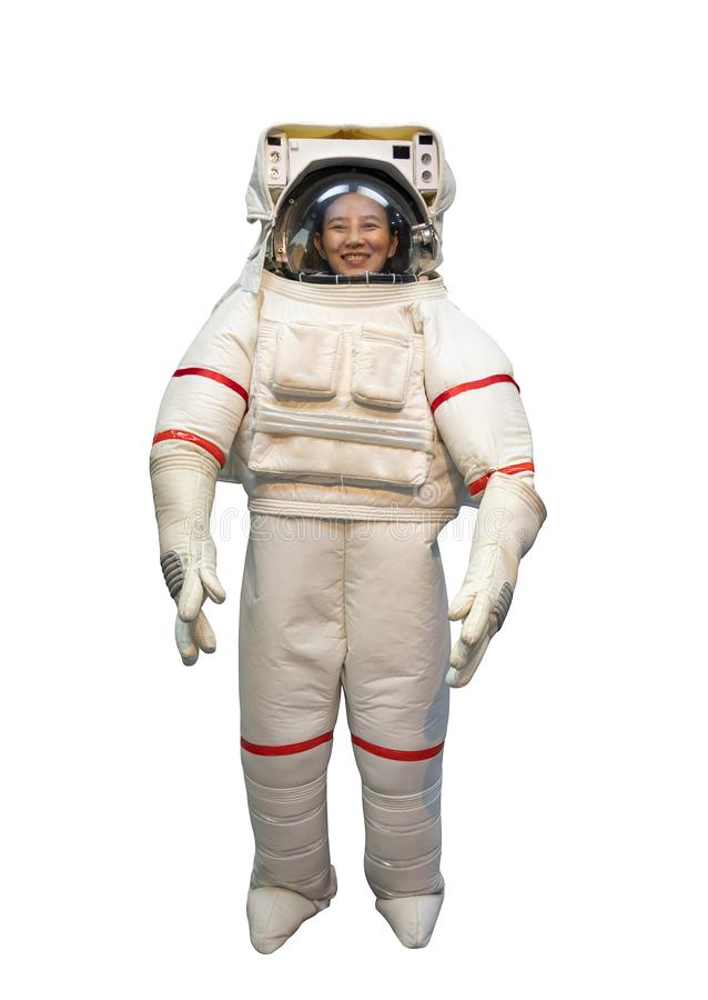 Happy Asian woman with big smile in white astronaut suit and astronaut helmet dreaming to be spacewoman isolate on white royalty free stock photography