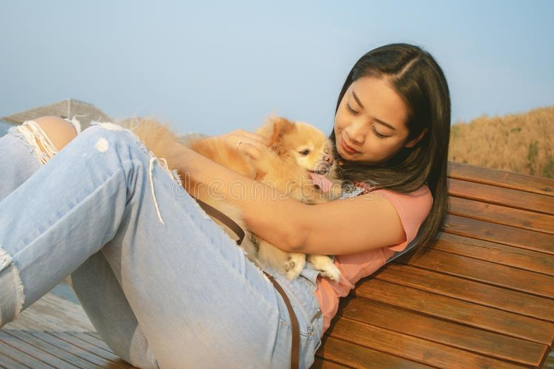 Happy Asian woman enjoy relax with her dog stock images