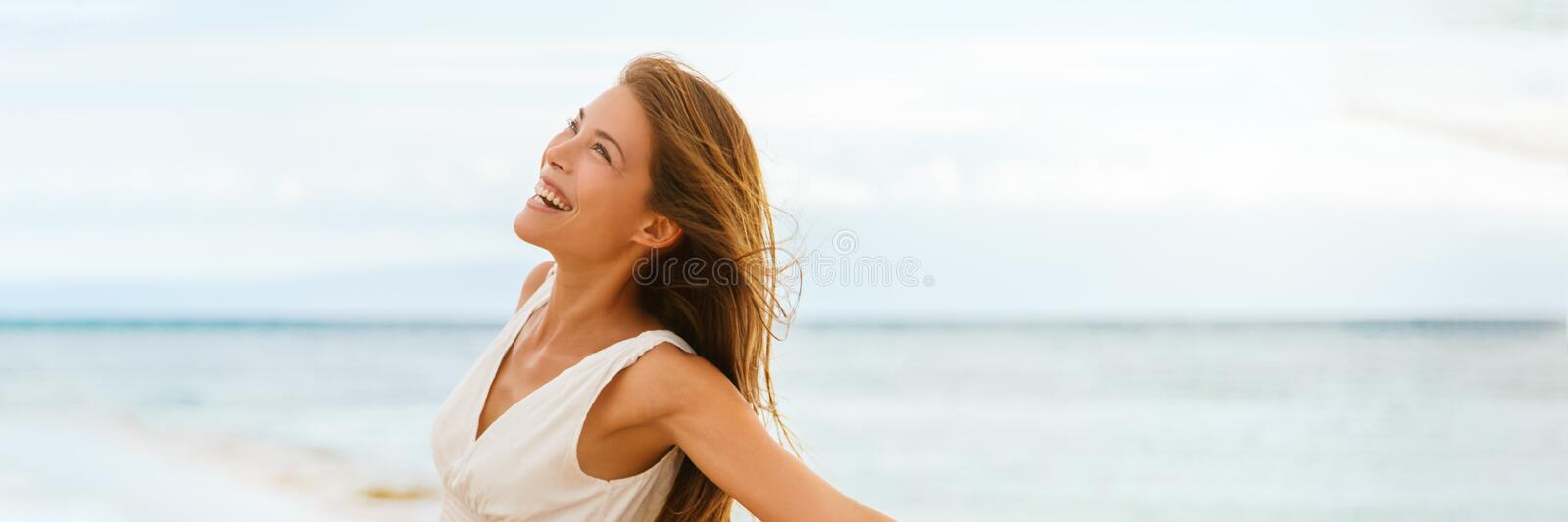 Happy Asian woman feeling good and free on ocean banner background on beach travel vacation panorama. Happy Asian woman feeling good and free on ocean banner stock photography