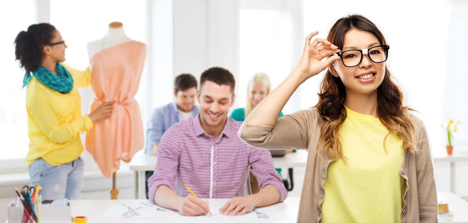 Happy asian woman in glasses or student stock image