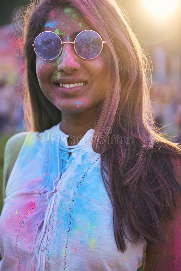 Happy Asian woman in holi colors at the summer festival royalty free stock photos