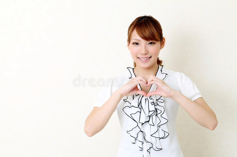 Happy Asian Woman Make Heart Shape By Her Hands Royalty Free Stock Image