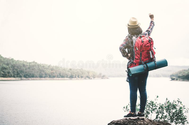 Happy Asian woman relaxing on holiday travel concept stock images
