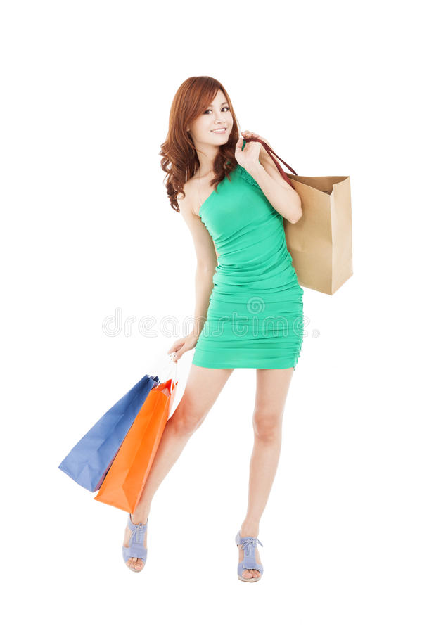 Happy asian woman with shopping bag stock photography