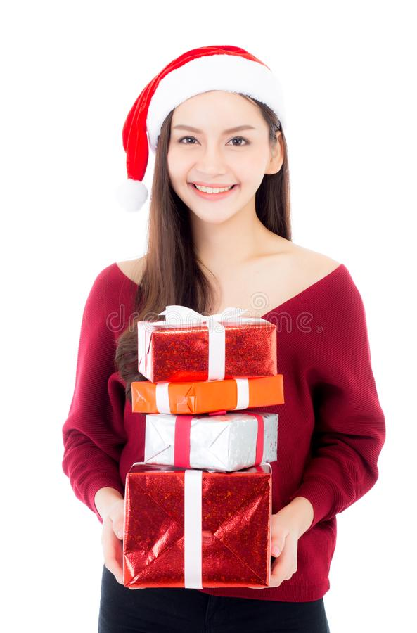 Happy asian woman with smile holding gift box many of xmas. Present girl with celebration christmas a holiday, girl with buyer isolated on white background royalty free stock images