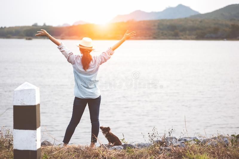 Happy asian woman stands with open arms enjoying time in outdoor stock photos