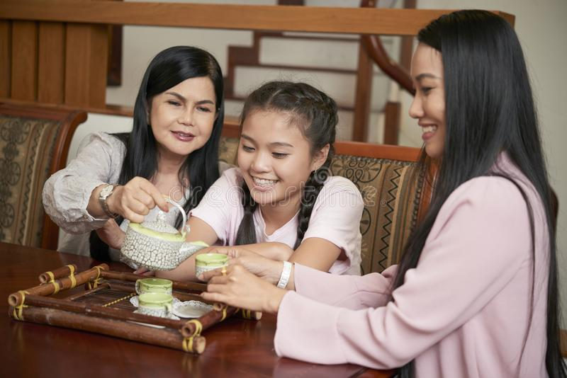 Happy Asian women of different generations having tea royalty free stock photo