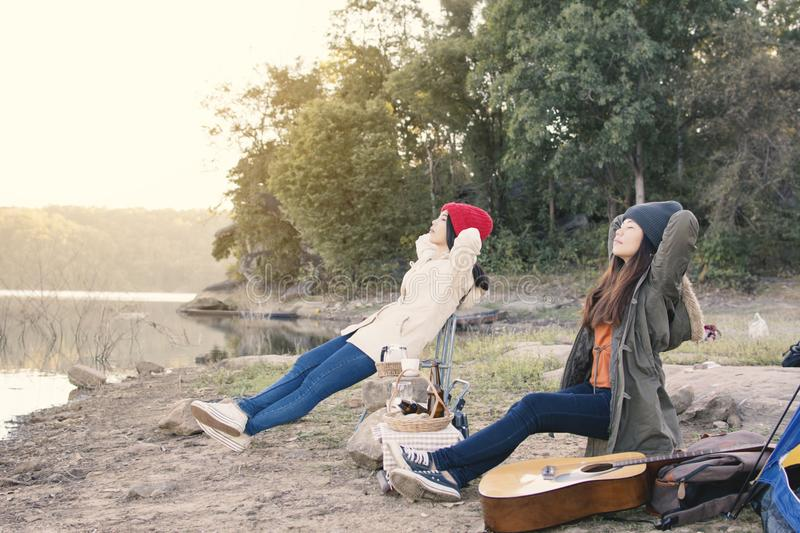 Happy Asian women relaxation in nature winter season. Concept travel and camping partnership,selective and soft focus,tone of hipster style royalty free stock images