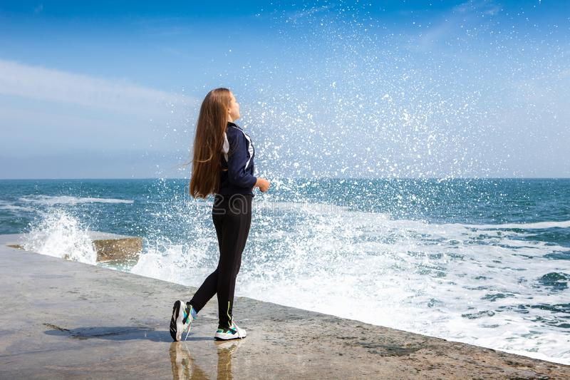 Happy Athletic girl on beach royalty free stock photography