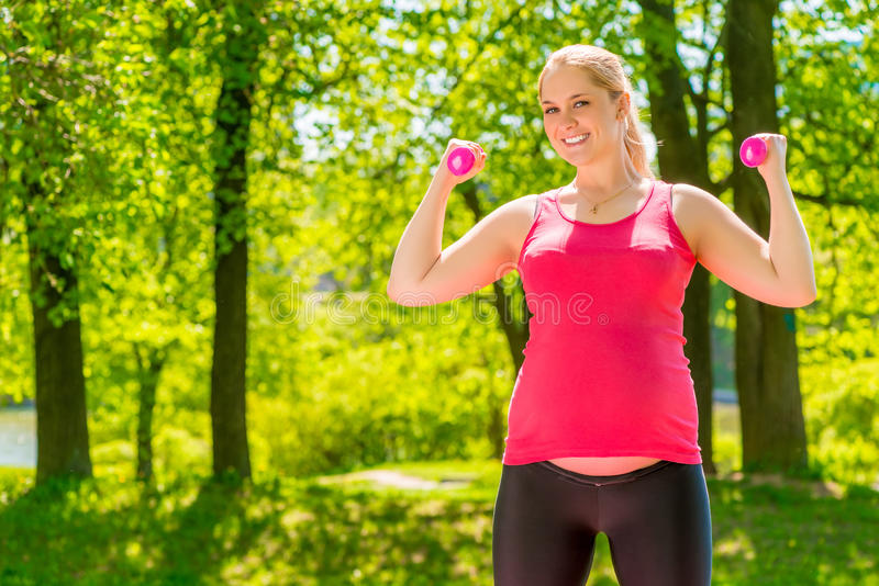 Happy athletic girl posing in a park stock photo