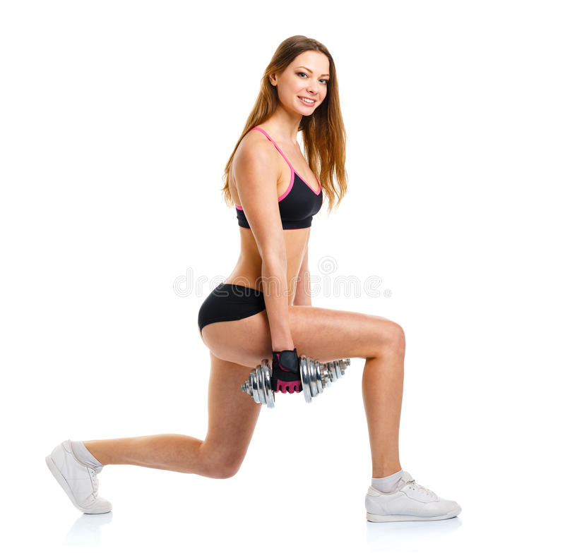 Happy athletic woman with dumbbells doing sport exercise, isolated on white royalty free stock photography