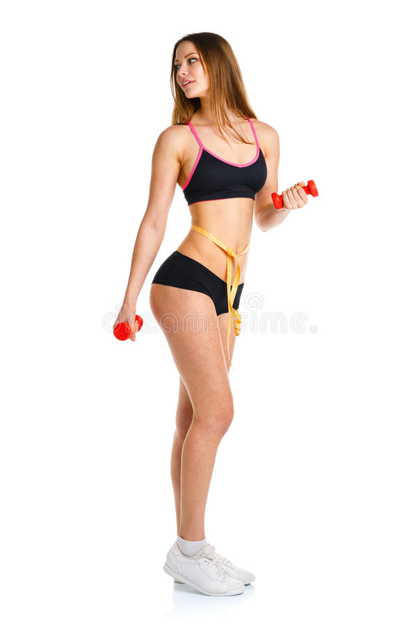 Happy athletic woman with dumbbells doing sport exercise, isolated on white stock photos