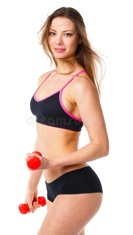 Happy athletic woman with dumbbells doing sport exercise, isolated on white royalty free stock photo
