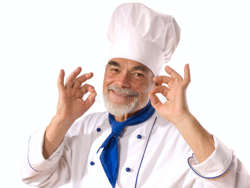 Happy attractive cook. Portrait of happy attractive cook on the white background royalty free stock photography