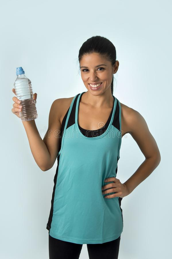 Happy and attractive latin sport woman in fitness clothes holdi royalty free stock images
