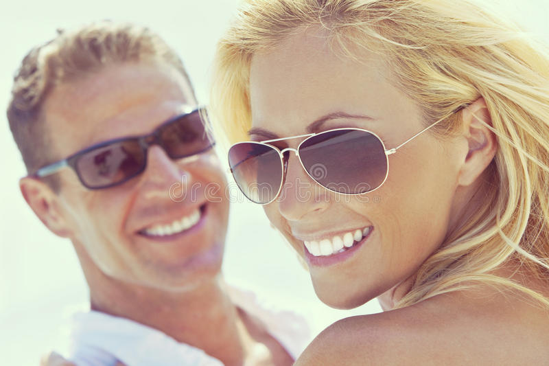 Happy Attractive Woman and Man Couple In Sunglasses At Beach stock image