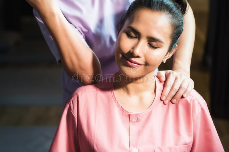 Thai massage to Asian beautiful woman royalty free stock images