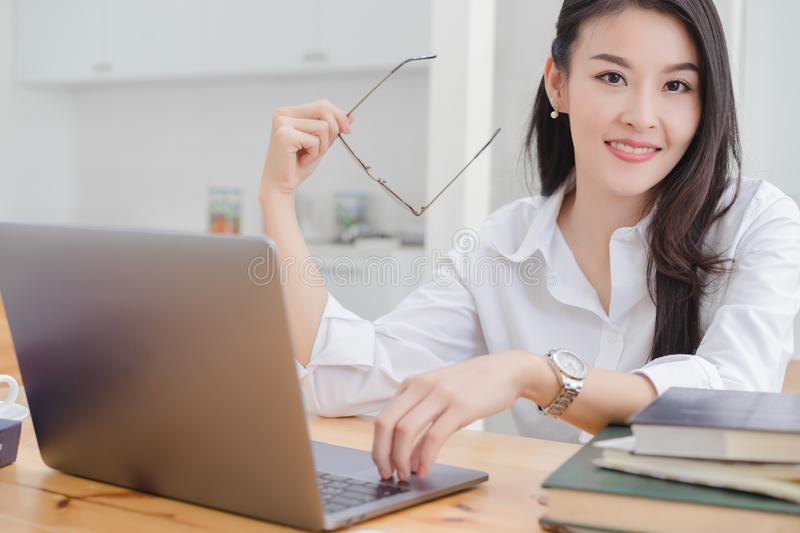 Happy attractive young asian business woman stock image