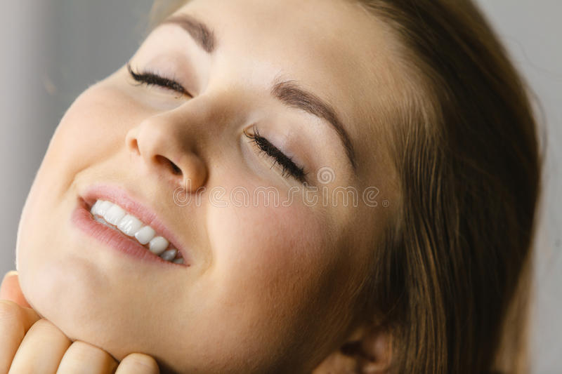 Happy attractive young woman with perfect skin stock images