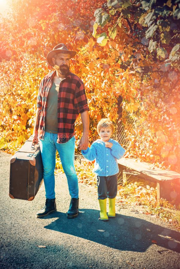 Happy autumn father and baby son playing and laughing on autumn walk. Both dad and child are laughing. royalty free stock photos